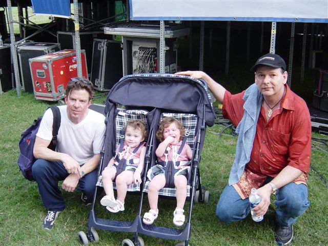 Double Trouble's Chris Layton and Tommy Shannon- (Stevie Ray Vaughn's rhythm section) with the beautiful Frederick Twins backstage at the Houston International Festival, April 26, 2002